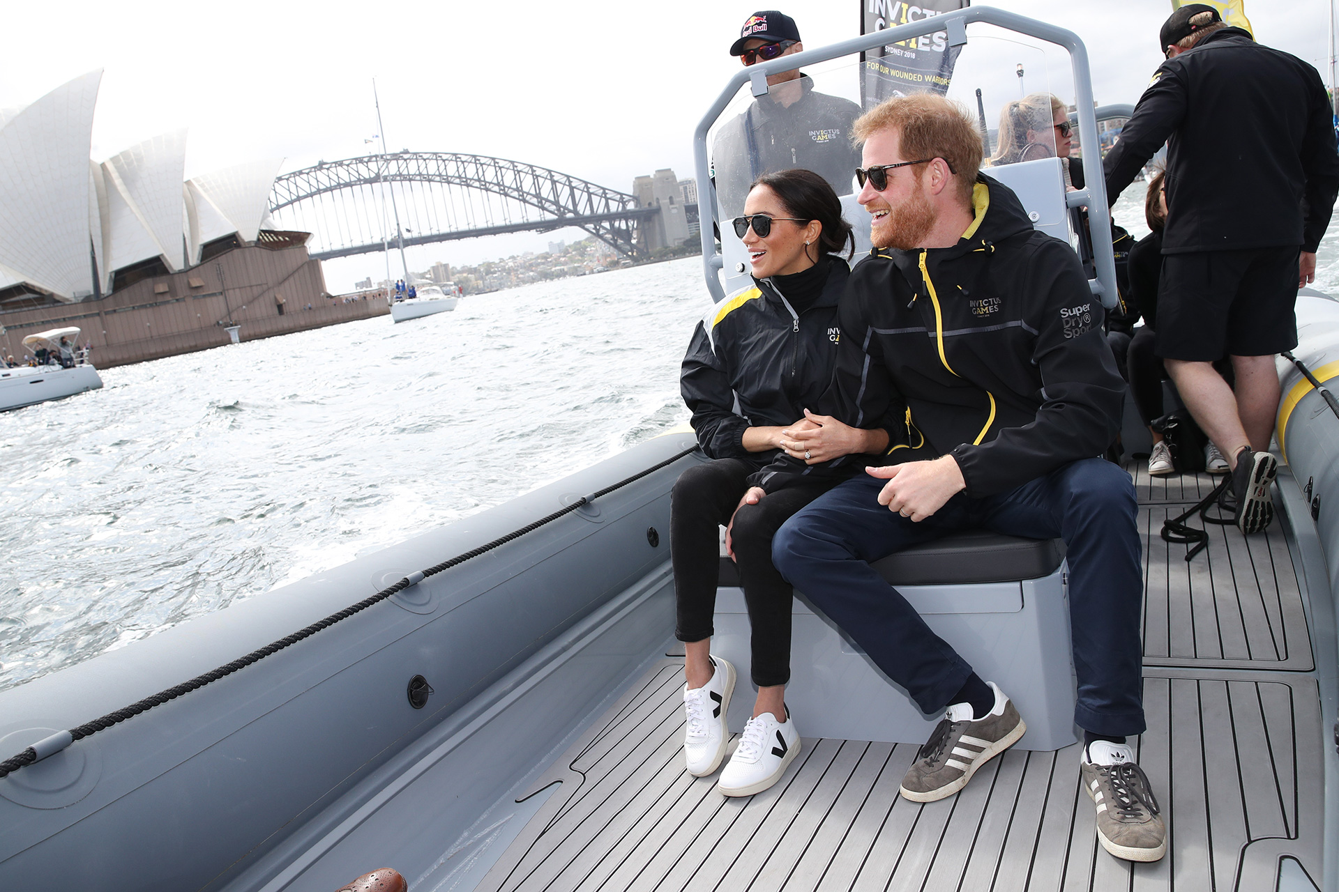 SYDNEY, AUSTRALIA - OCTOBER 21: Prince Harry, Duke of Sussex and Meghan, Duchess of Sussex on Sydney Harbour looking out at Sydney Opera House and Sydney Harbour Bridge during day two of the Invictus Games Sydney 2018 at Sydney Olympic Park on October 21, 2018 in Sydney, Australia.