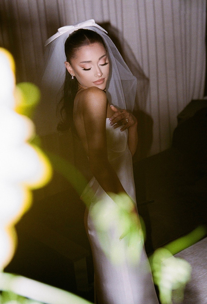 Ariana Grande in her wedding dress and veil
