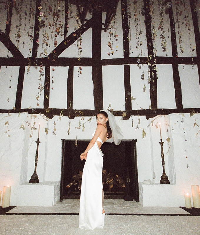 Ariana Grande at home, with flowers hanging from the ceiling for her wedding