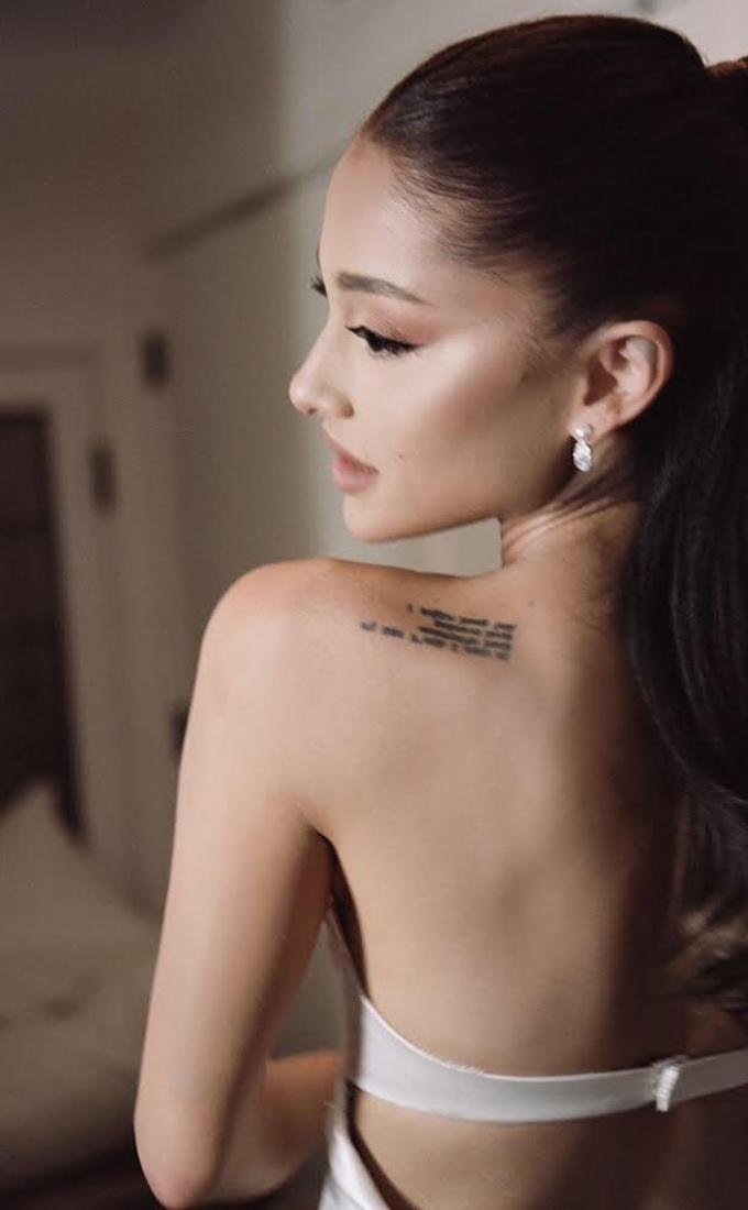 Back shot of Ariana Grande in her wedding dress