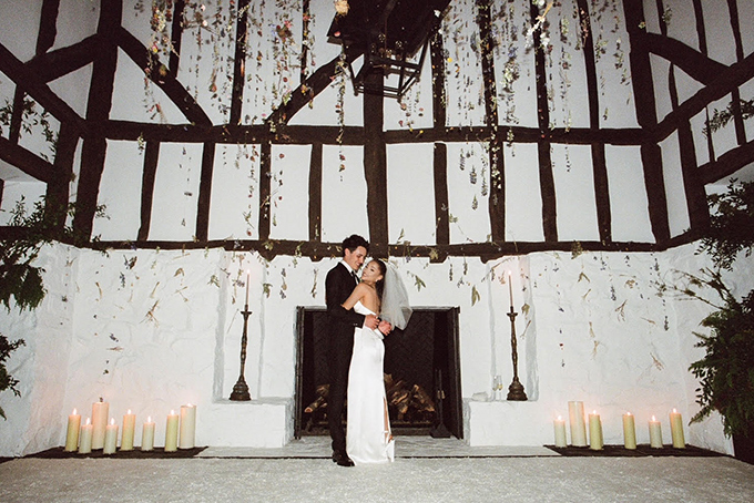 Ariana Grande and Dalton Gomez posing during their at-home wedding