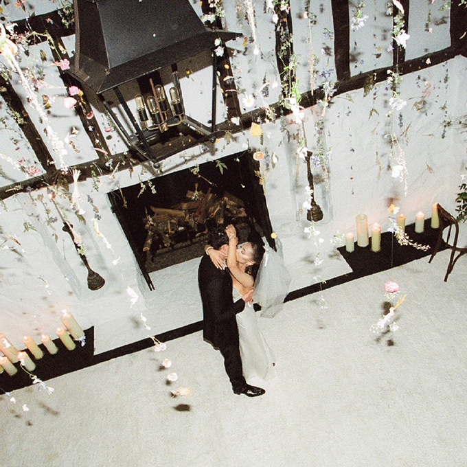 Aerial shot of Ariana Grande and Dalton Gomez embracing during their at-home wedding