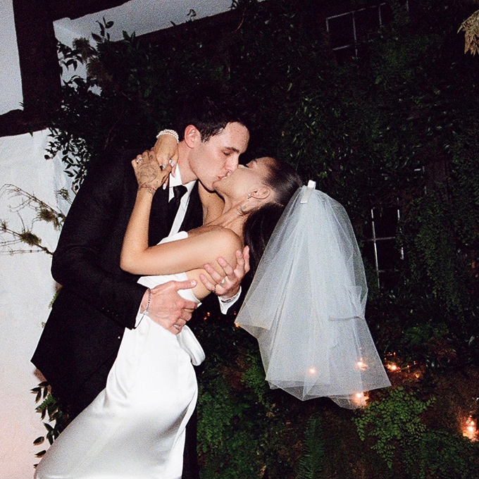 Dalton Gomez and Ariana Grande kissing during their at-home wedding