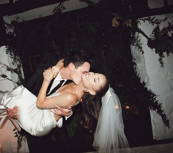 Dalton Gomez carrying and kissing Ariana Grande during their at-home wedding