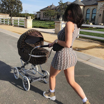 Kylie Jenner pushing her daughter, Stormi Webster, in a Fendi pram