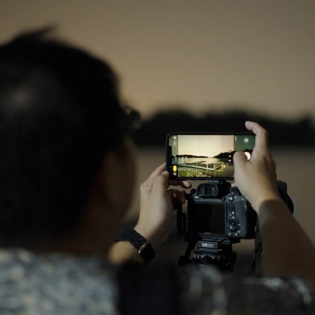 Darren Soh taking photographs at night