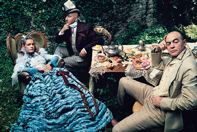 alice in wonderland: Natalia Vodianova (as Alice), Stephen Jones (as the Mad Hatter) and Christian Lacroix, American Vogue, December 2003