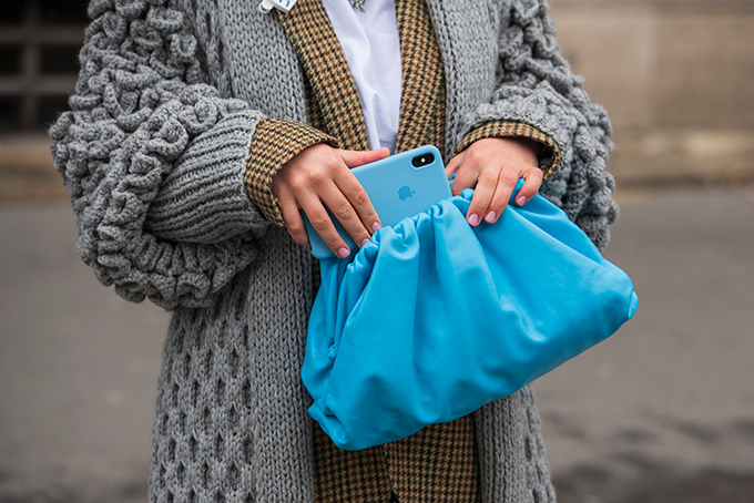 Woman putting iPhone into bag